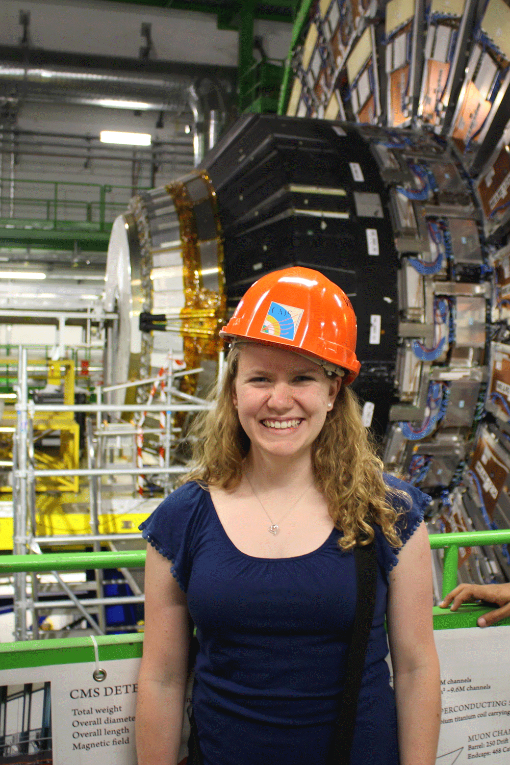 The author Allison Reinsvold in front of the CMS detector at CERN. Photo: CERN