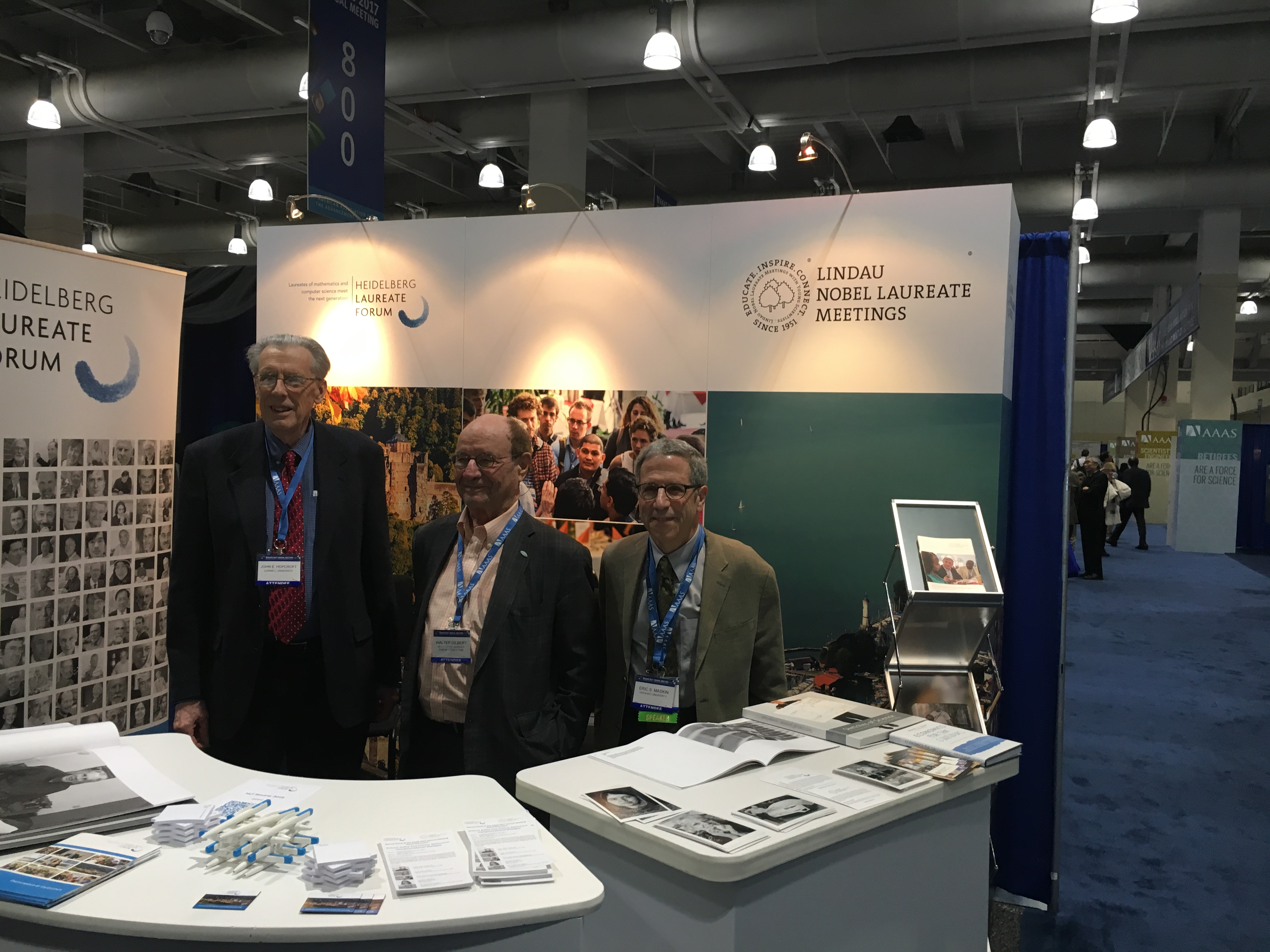 Turing Ward winner John Hopcroft and Nobel Laureates Wally Gilbert and Eric Maskin visiting the booth of the Lindau Meetings and the HLF at the AAAS Meeting. Photo: Wolfgang Huang