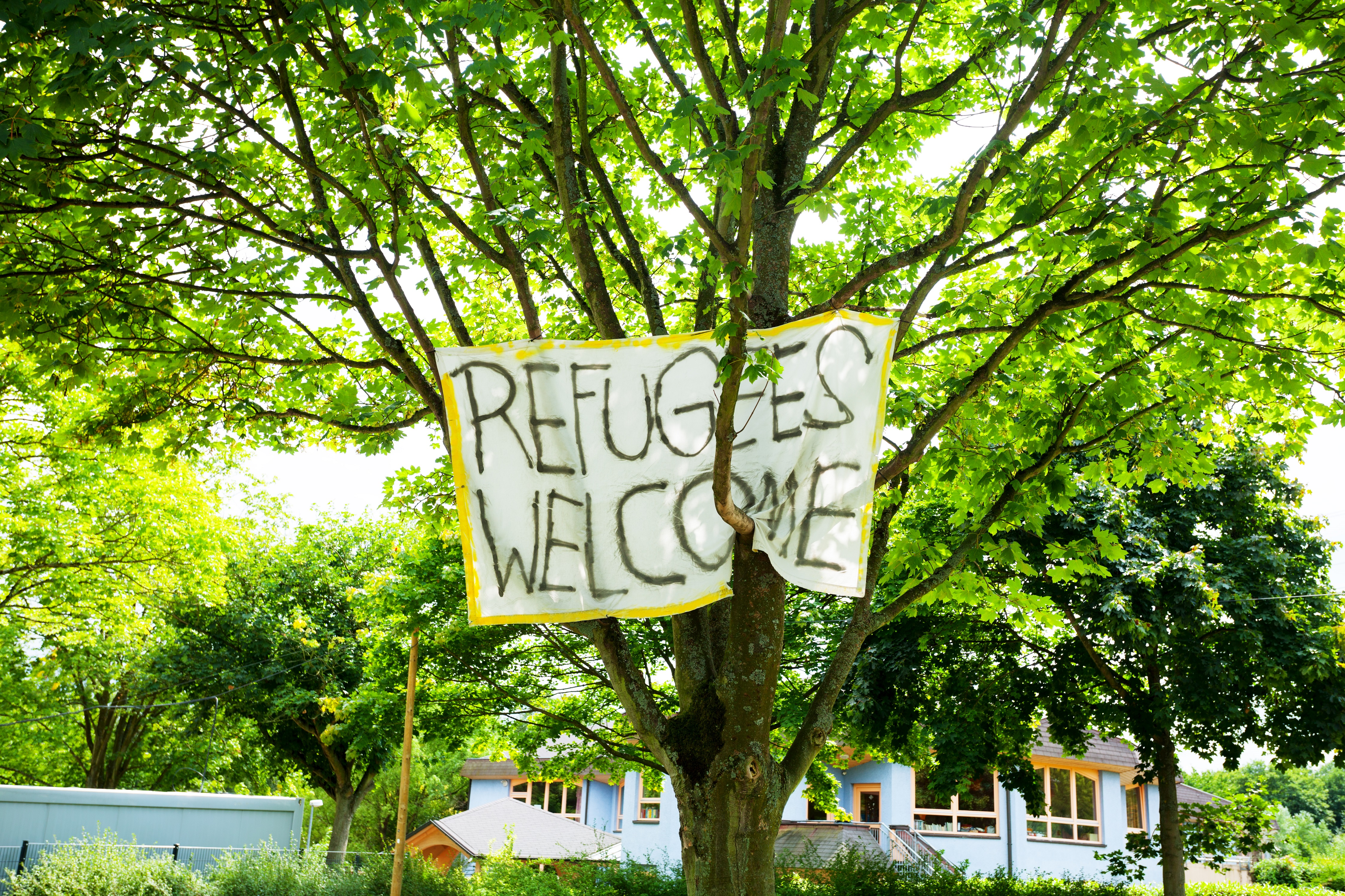 Refugees Welcome Banner in Dortmund, Germany. Photo/Credit: Michael Luhrenberg/iStock.com
