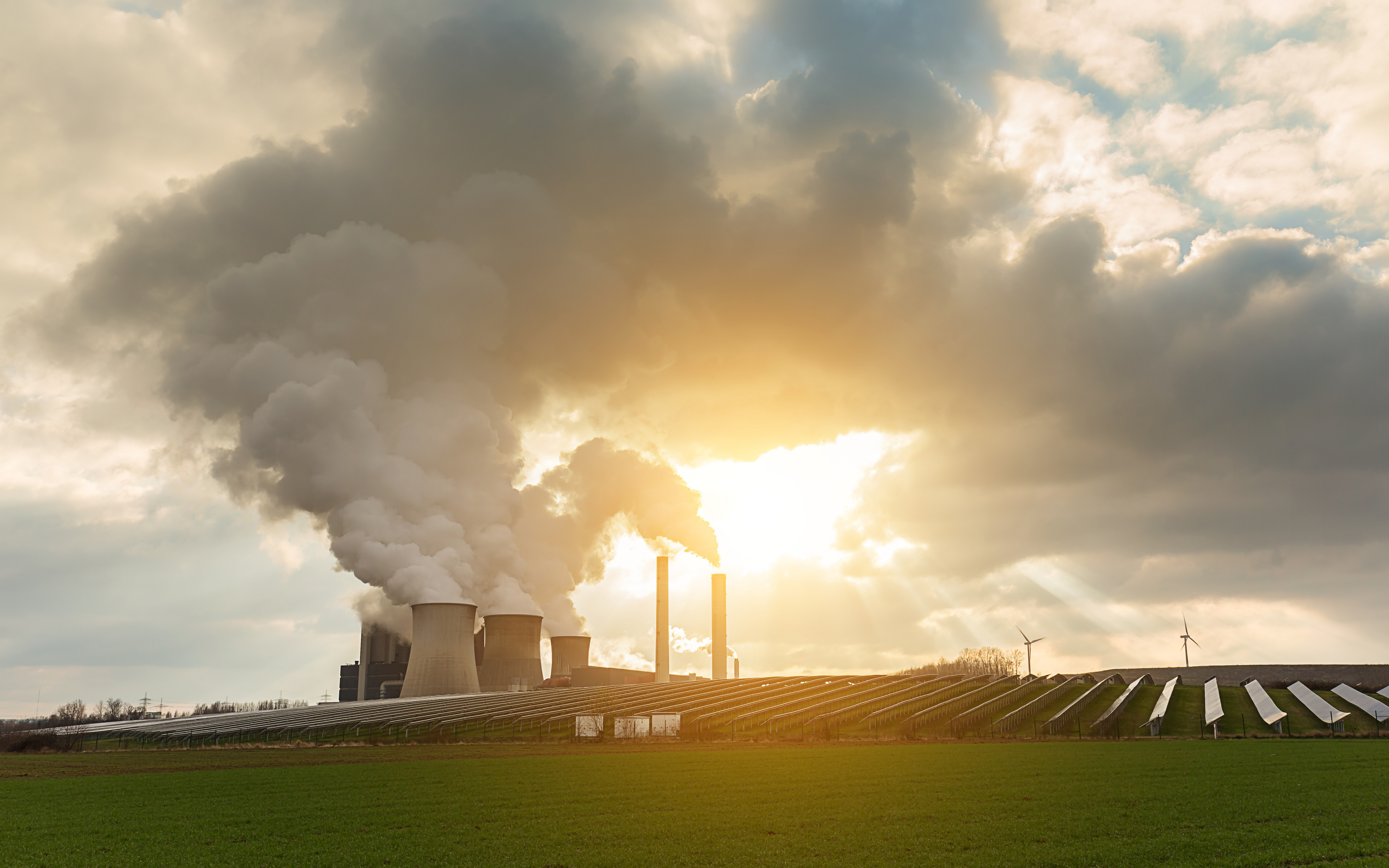 A Coal-fired power plant, solar energy and windmills. Photo/Credit: rclassenlayouts/iStock.com