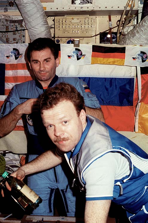 German Astronaut, Reinhold Ewald with Mir-23 commander Vasily Tsibliev in the background, in Mir's Base Block. (NASA)