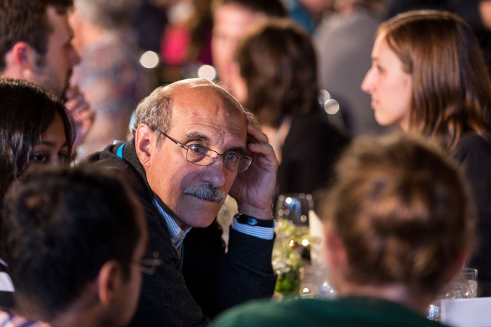 Chemistry Nobel Laureate Martin Chalfie listening closely in a conversation with a young researcher. Photo: C.Flemming/Lindau Nobel Laureate Meetings