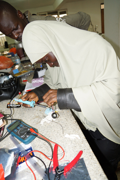Participant of the 2nd IBRO school on insect neuroscience and Drosophlia neurogenetics organized by TReND in 2013, while constructing her own electrophysiology amplifier from  Backyardbrains (www.BackyardBrains.com). Credit: TReND in Africa