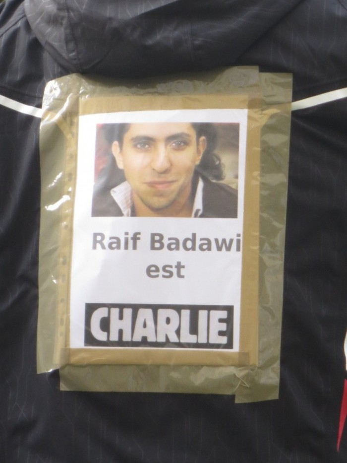 Raif Badawi's picture on the back of a participant on March 11, 2015, druing the rally against violence and for freedom of speech. Photo: Alvaro, Wikimedia CCL
