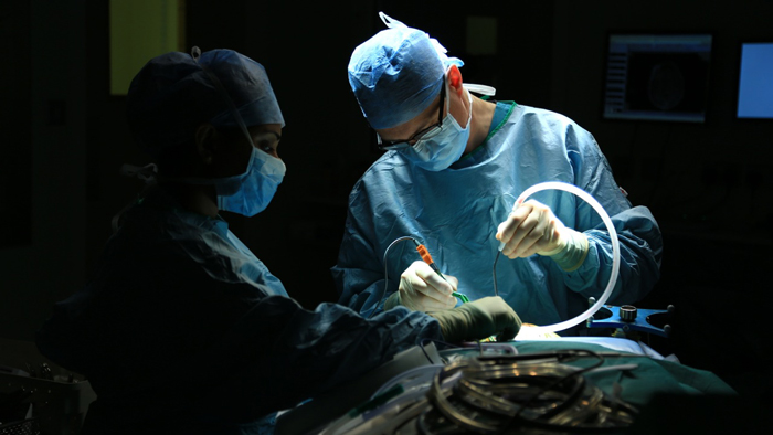 Doctors preparing for surgery. Photo: Dominic Hill
