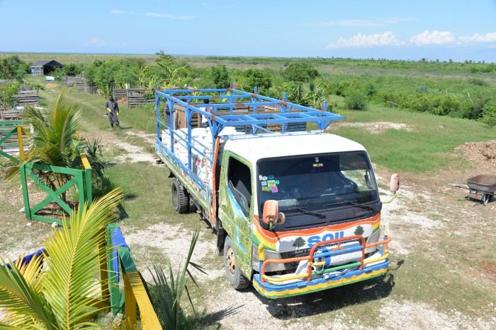 A 'Poopmobile' collecting pails from UDDTs and bringing them to a central composting site in Port-au-Prince, Haiti. The American nonprofit organization SOIL implemented this sanitary solution. Photo: Gruster, Creative Commons Attribution-Share Alike 4.0 International license