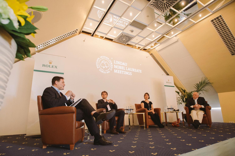 From left to right: Moderator Mark Kendall, Arnau Boetsch (Director of Communication and Image at Rolex SA), Bettina Heim from ETH Zurich and Nobel Laureate Kurt Wüthrich. Photo: J. Nimke/Lindau Nobel Laureate Meetings