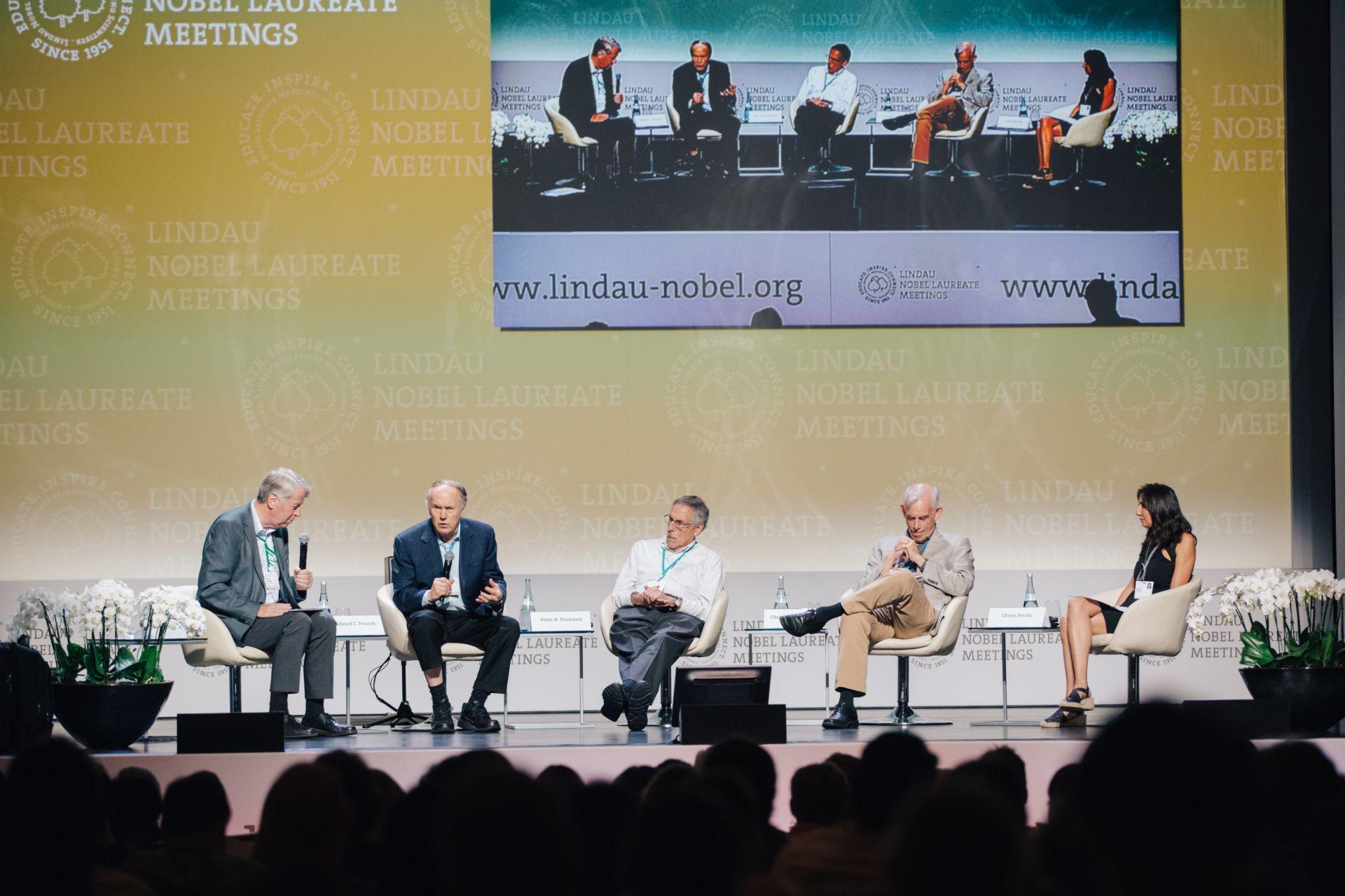 Panel discussion during the 6th Lindau Meeting on Economic Sciences. Picture/Credit: Julia Nimke/Lindau Nobel Laureate Meetings